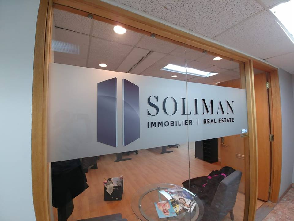 Soliman - Office sign with vinyl and frosted material